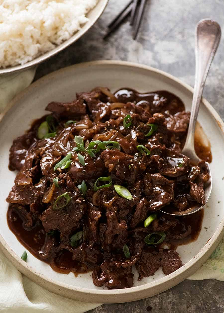 Chinese Honey Pepper Beef on a plate with rice on the side, ready to be served