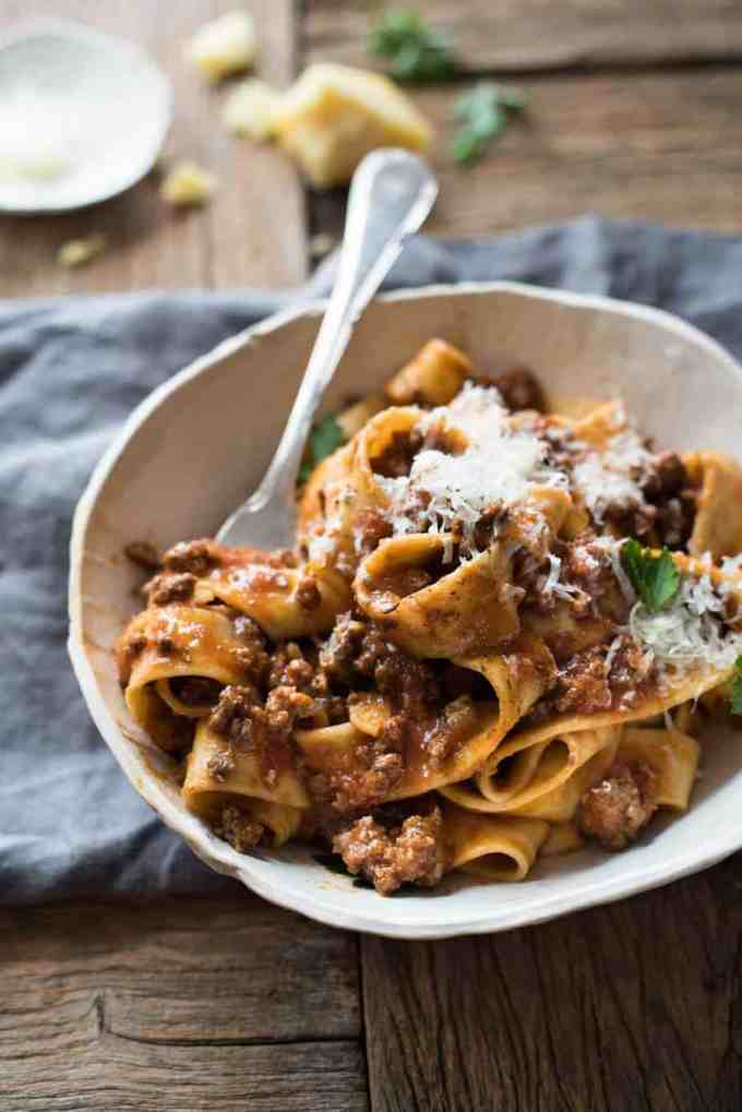 A bowl of Italian Sausage & Beef Ragu Sauce topped with grated parmesan