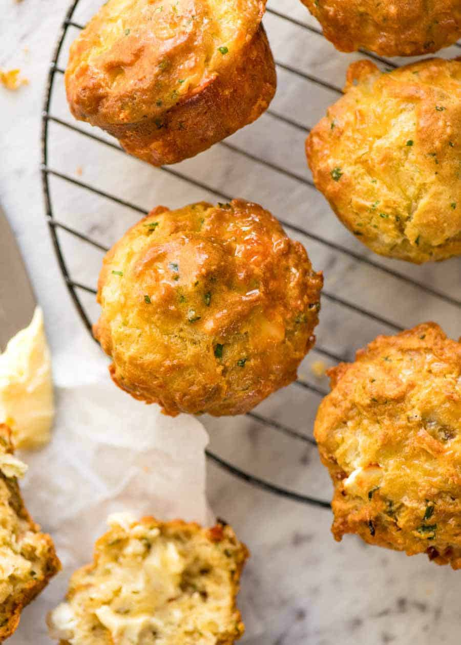 Overhead photo of Savoury Cheese Muffins cooling on a baking rack, fresh out of the oven.