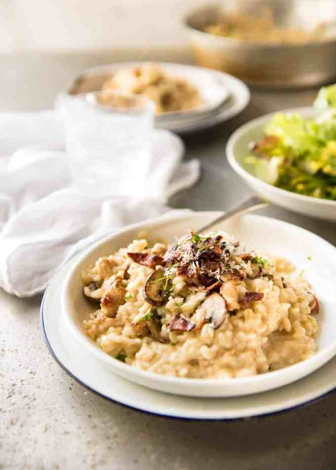 Chicken and Mushroom Risotto - Creamy risotto with golden brown sautéed mushrooms and chicken. Easy, perfectly seasoned and beautifully creamy! www.recipetineats.com