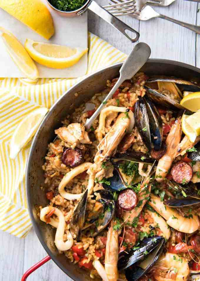 Spanish Paella - The right rice, right amount of liquid and the base flavour of garlic, onion and saffron is the foundation of a great Paella. This is a classic chicken & seafood paella, but you can vary it as you wish! www.recipetineats.com