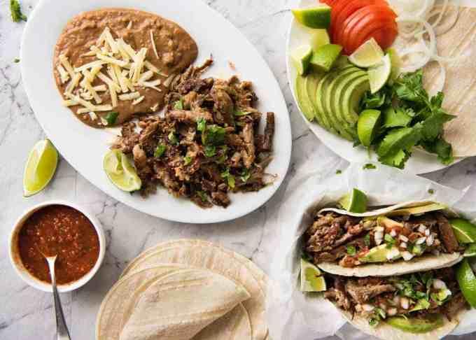Pork Carnitas Tacos and sides