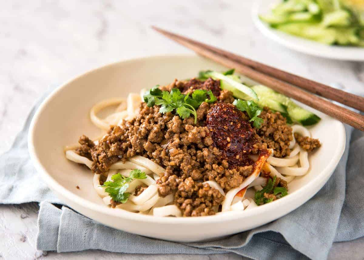 """Chinese Pork with Noodles (Zha Jiang Mian) - Super quick and super tasty, affectionally known as """"Chinese Bolognese"""". The pork is savoury with a touch of heat and spice, perfect mixed through noodles! www.recipetineats.com"""