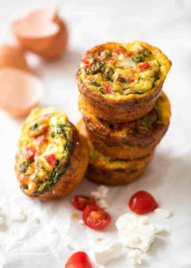 Healthy doesn't have to be bland! These Healthy Egg Muffins are a great grab & go breakfast option. Egg, spinach, feta, cherry tomatoes and bell peppers/capsicum. www.recipetineats.com