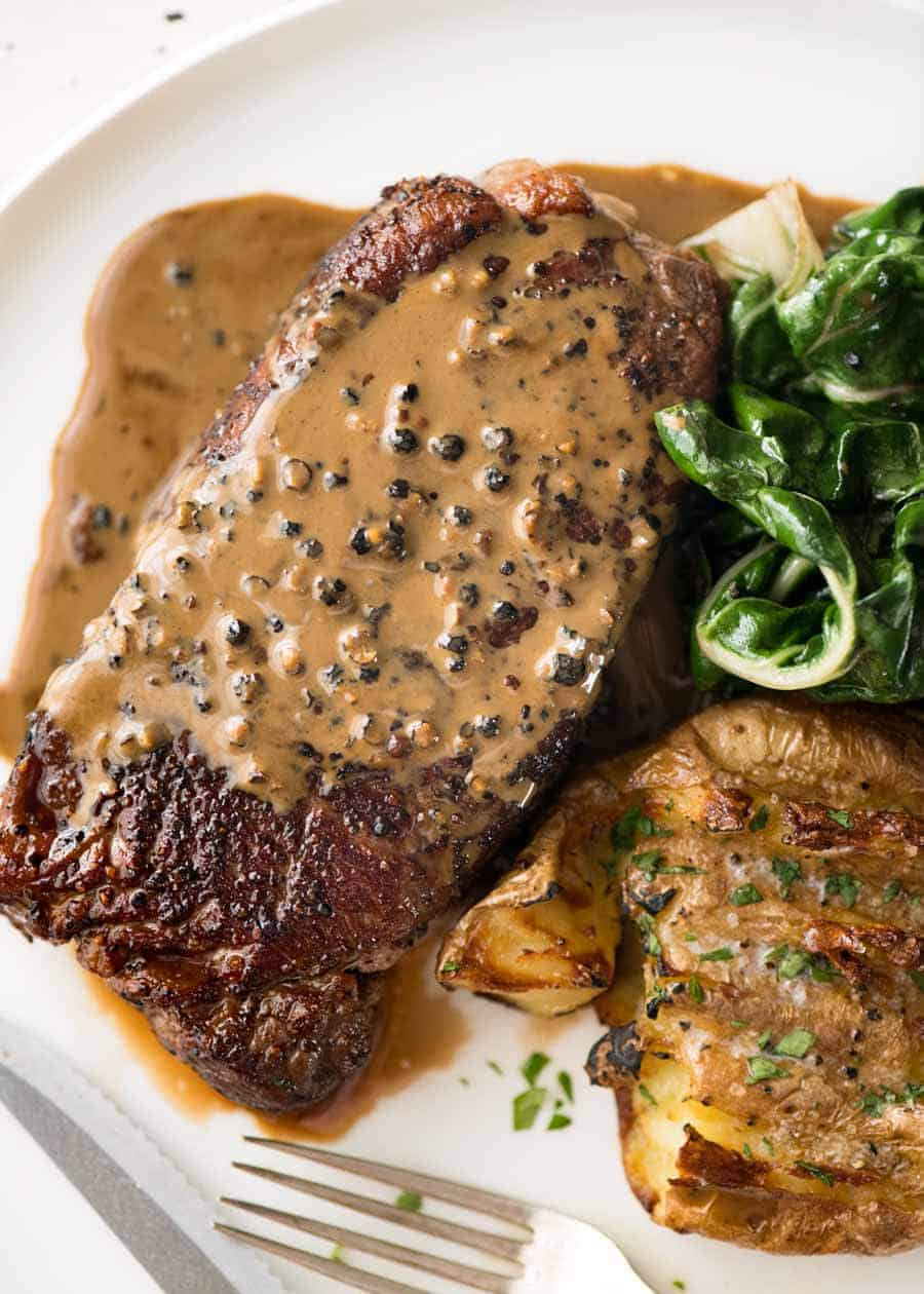 Overhead photo of Creamy Peppercorn Sauce on steak.