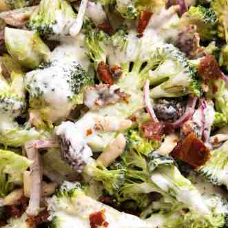 Close up of Broccoli Salad with Lighter Creamy Dressing with bacon, almonds, cranberries and red onion