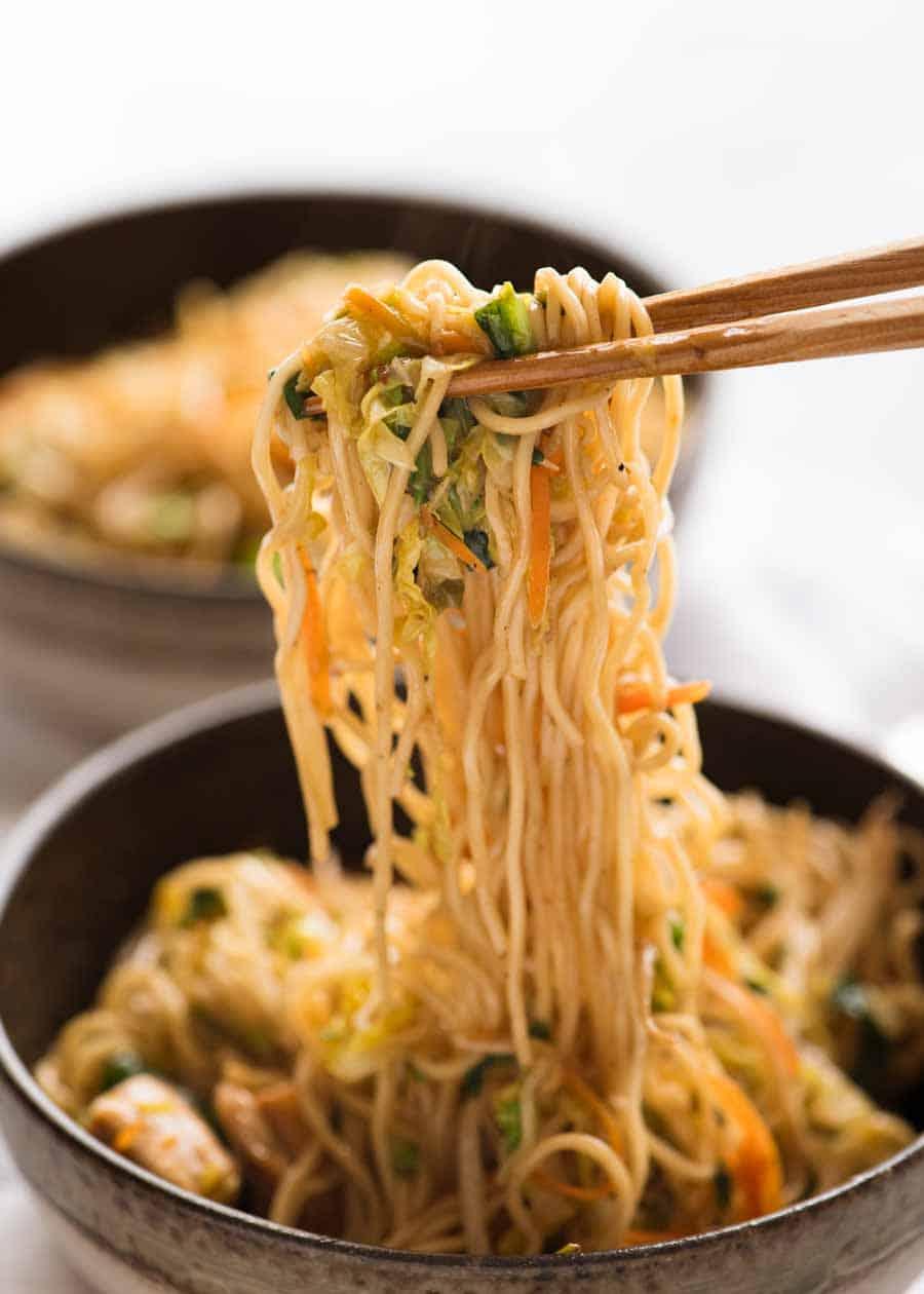 Chopsticks picking up Chow Mein noodles
