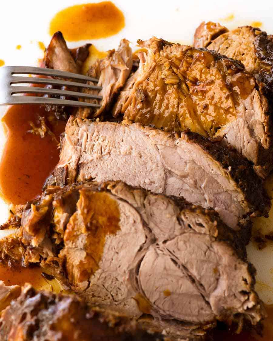 Slices of Slow Cooker Pork Loin Roast with Honey Butter sauce