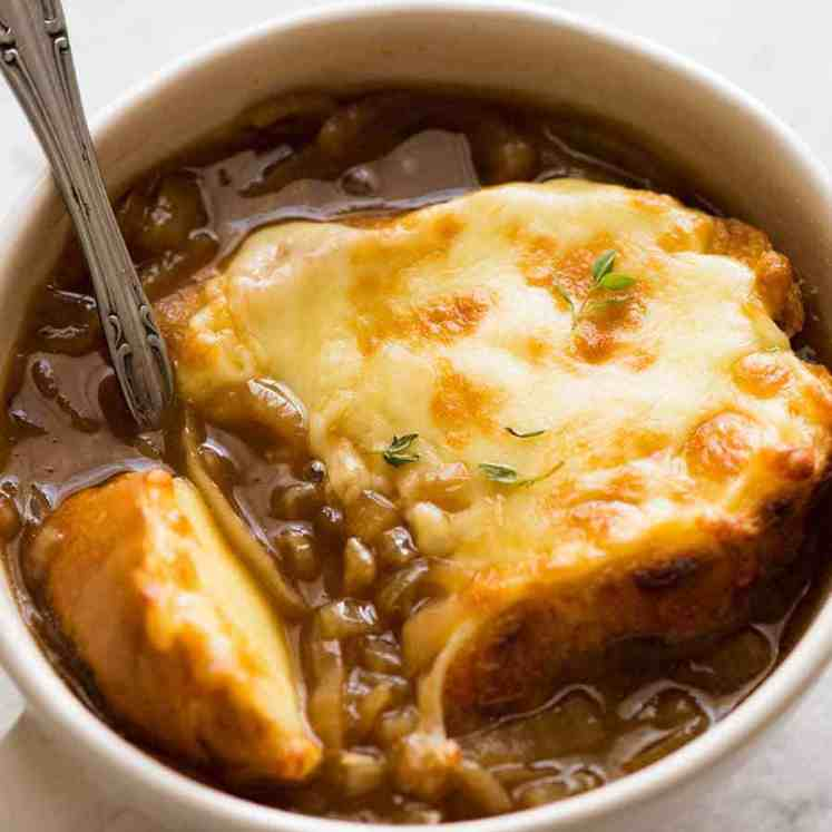 Close up of French Onion Soup with cheese toast