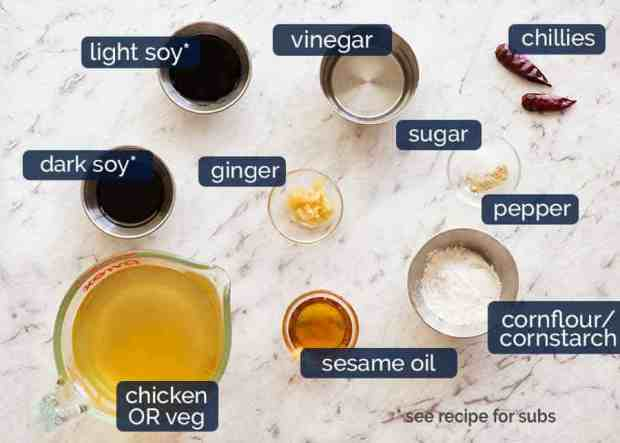 Ingredients for hot and sour soup broth - chicken or vegetable broth, soy sauce, sesame, vinegar, chilli, ginger, cornstarch, pepper, sugar