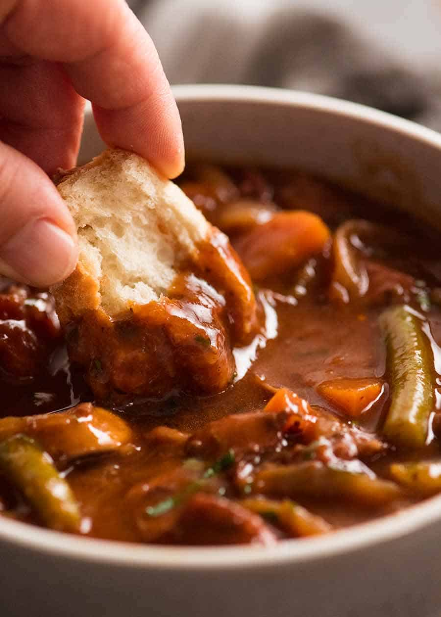 Dipping crusty into Chicken Stew