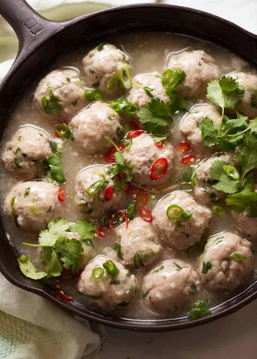 Overhead close up photo of Vietnamese Pork Meatballs for Banh Mi Vietnamese Sandwich in a black skillet