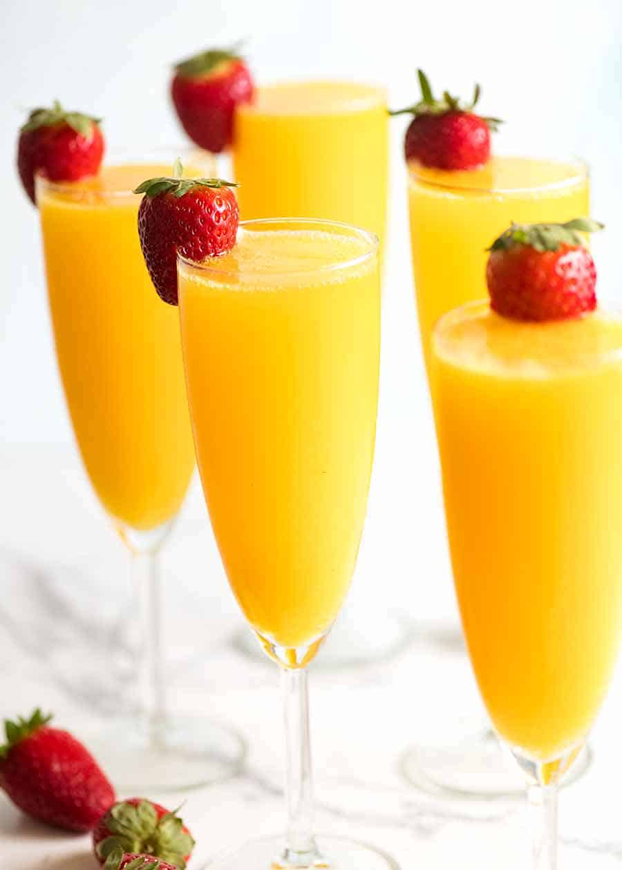 Champagne flutes filled with Mimosas