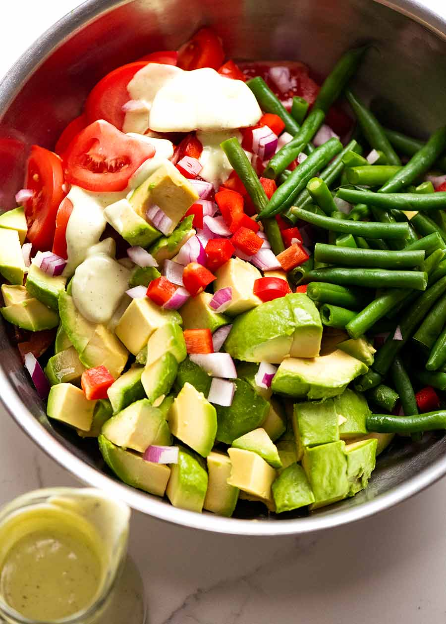 Bowl of Green Bean Avocado Salad with Avocado Dressing ready to be tossed
