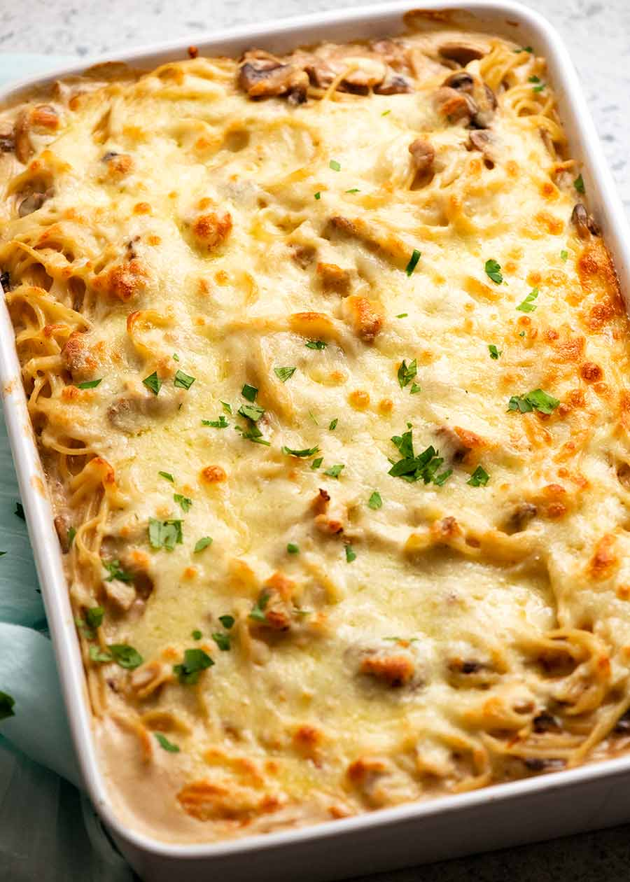 Pan of Chicken Tetrazzini - creamy chicken mushroom pasta bake, fresh out of the oven