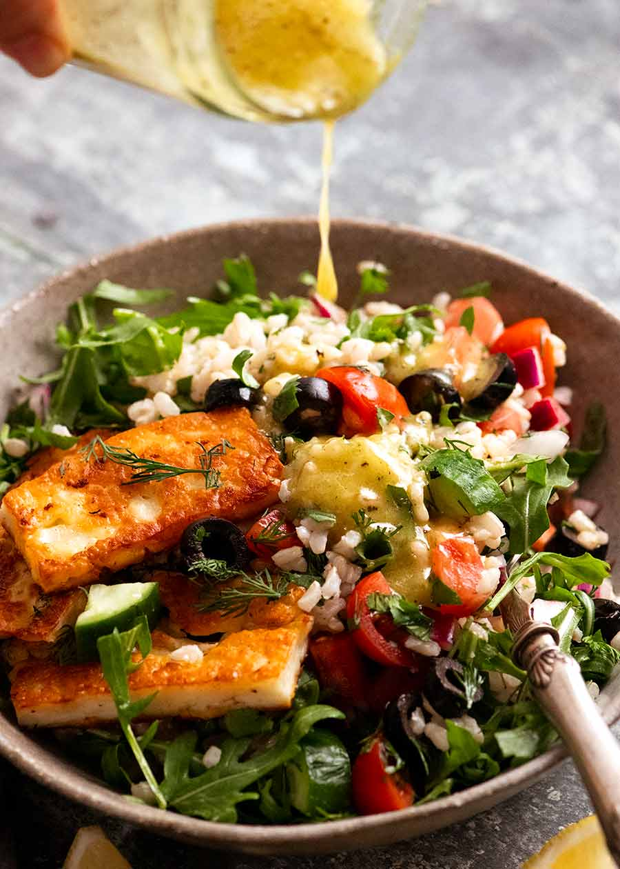 Drizzling lemon dressing over Brown Rice Salad