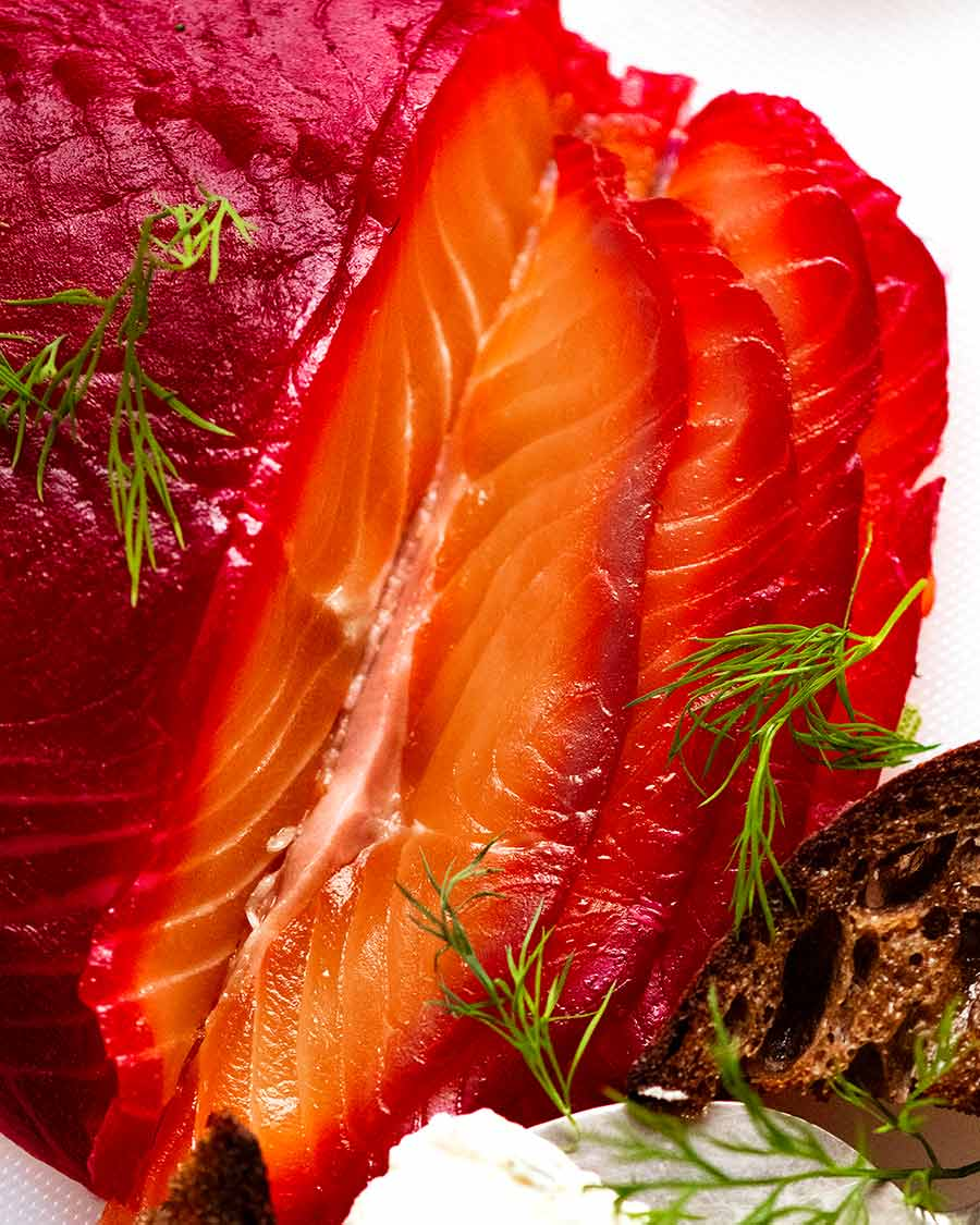 Close up photo of slices of Beetroot Cured Salmon (Gin or Vodka, Salmon Gravlax)
