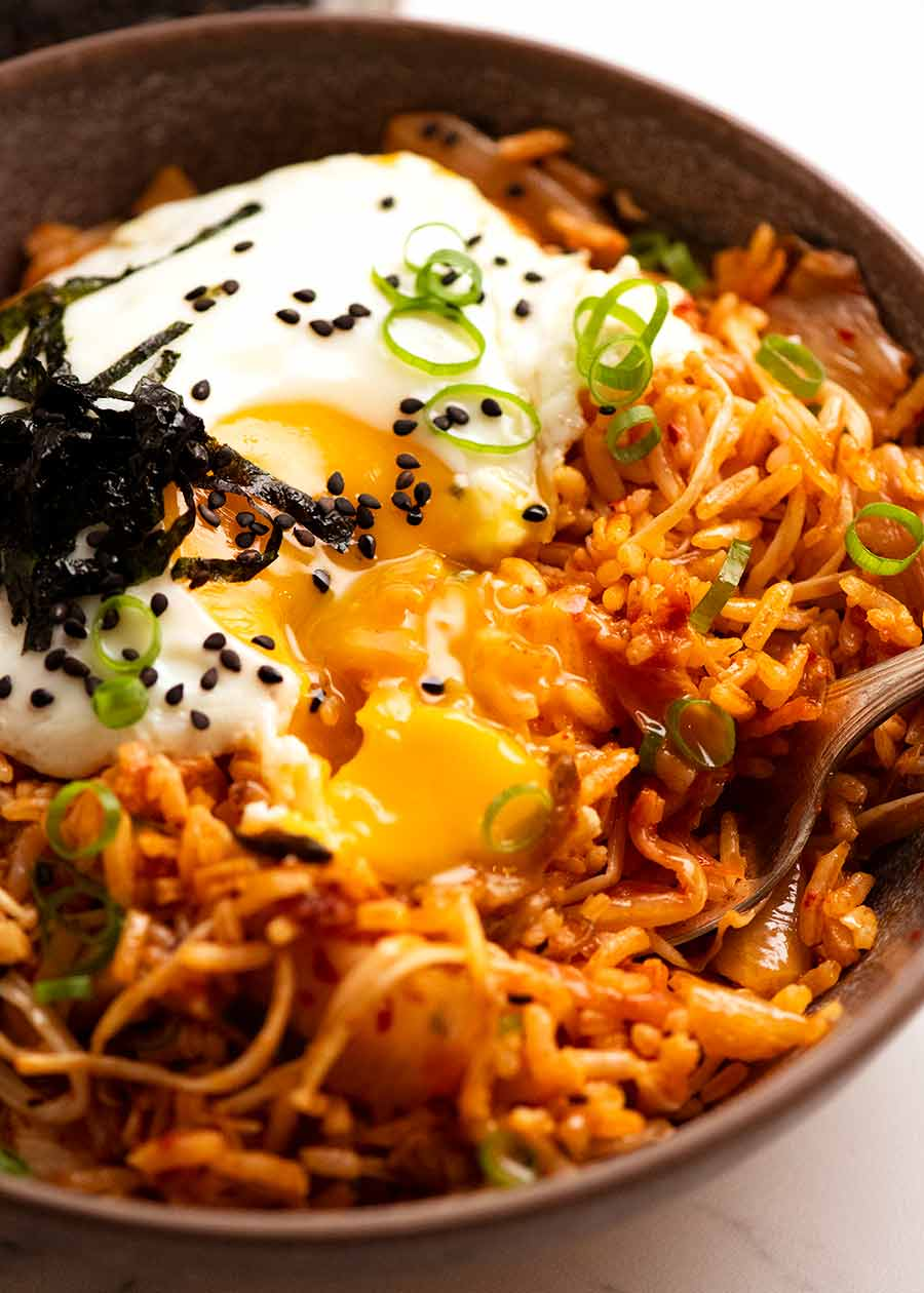 Close up of bowl of Kimchi Fried Rice with runny yolk
