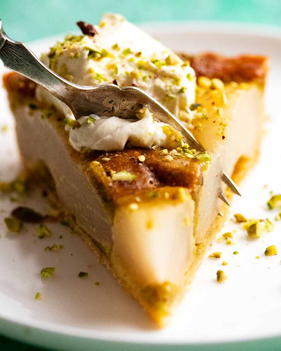 Fork cutting into a slice of Pistachio Pear Tart