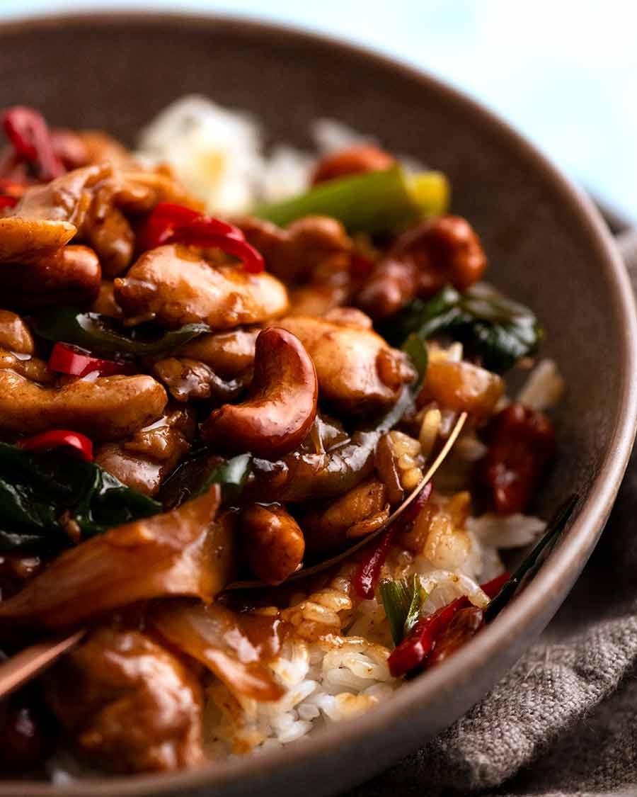 Close up photo of Thai Cashew Chicken Stir Fry served over jasmine rice