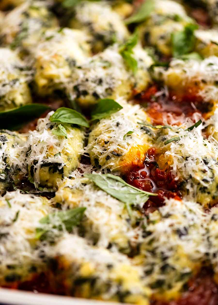 Close up photo of Malfatti - Italian Spinach Ricotta Dumplings, ready to be served