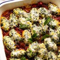Pan of freshly cooked Malfatti - Italian Spinach Ricotta Dumplings ready to be served
