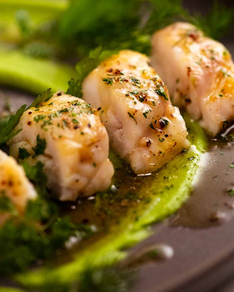 Close up photo of Monkfish recipe with pea puree and herb brown butter