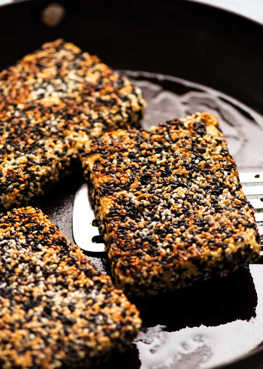 Sesame Crusted Tofu Steaks in a skillet