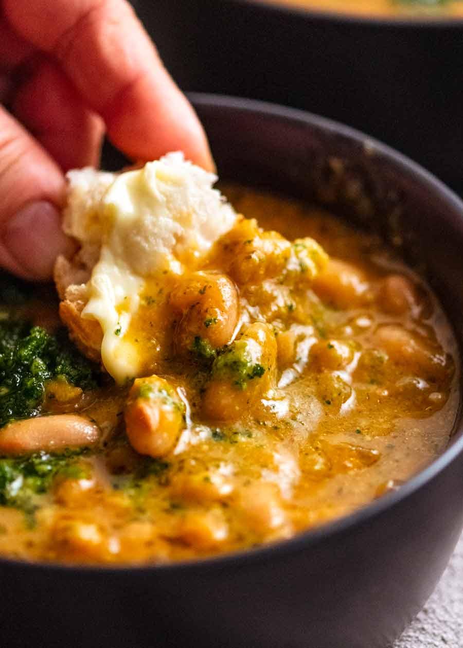 Dunking crusty bread into El Bulli Bean Soup with Picada