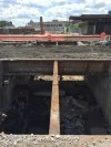 Top of the mail tunnel removed. Photo is taken from between the tracks facing south with the post office in the background. 6-26-15 [PHOTO: NYSDOT]