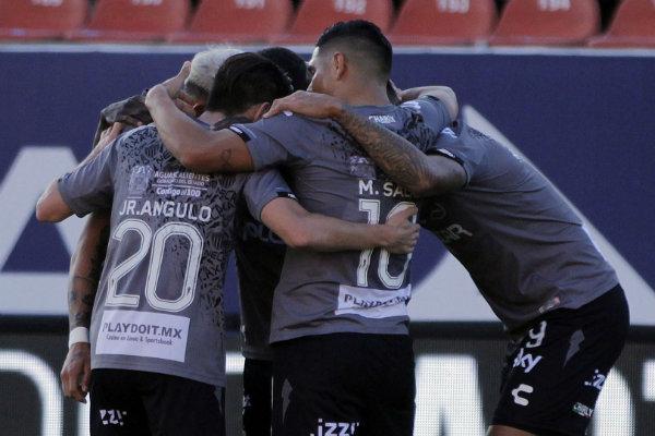 Necaxa players celebrate a goal