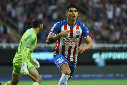 Alan Pulido celebrates a goal with Chivas