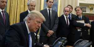 Trump signs executive order on abortion surrounded by men