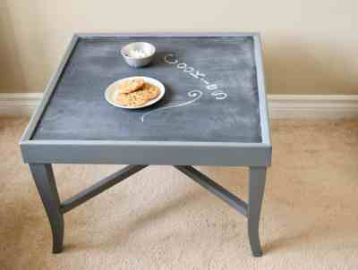 Square vintage table painted grey with a chalkboard on top