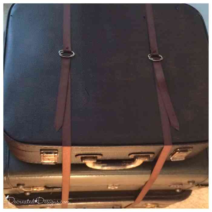 ribbon straps on a stack of vintage suitcases