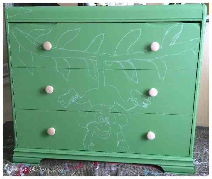 chalking out a design to paint on a dresser