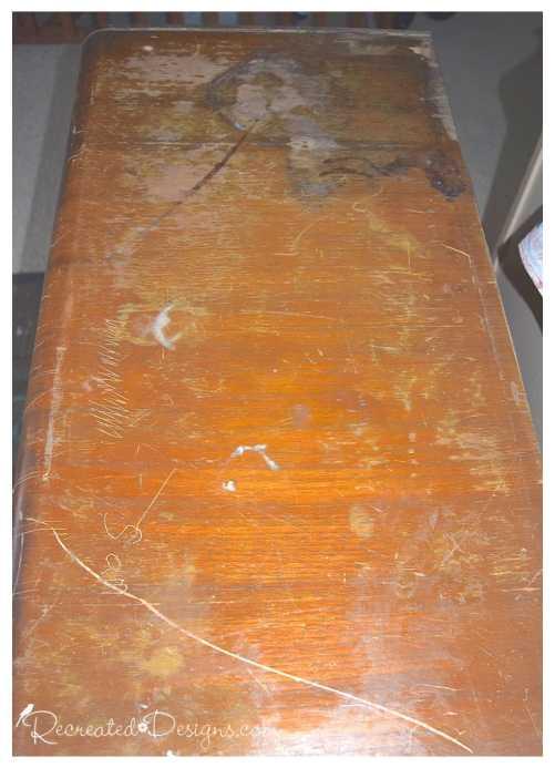 antique dresser in bad shape with missing veneer