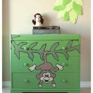 antique dresser painted with a monkey