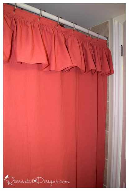 a coral coloured DIY shower curtain