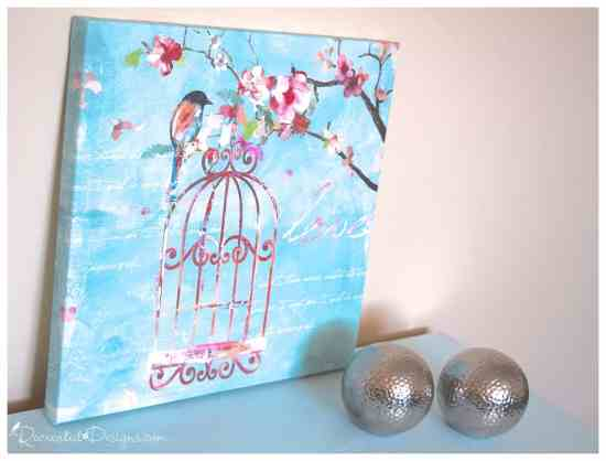 a gorgeous bird picture of blues and pinks on top of a vintage dresser