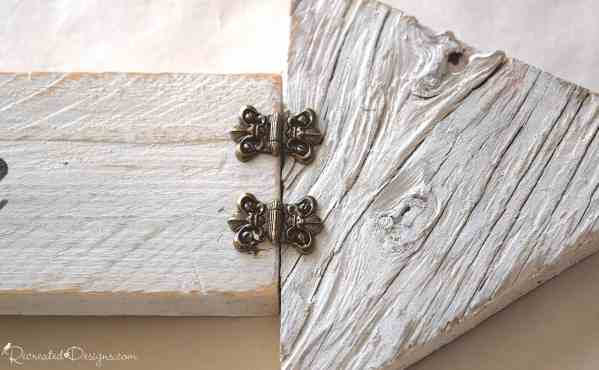 brass coloured vintage hardware on white painted wood
