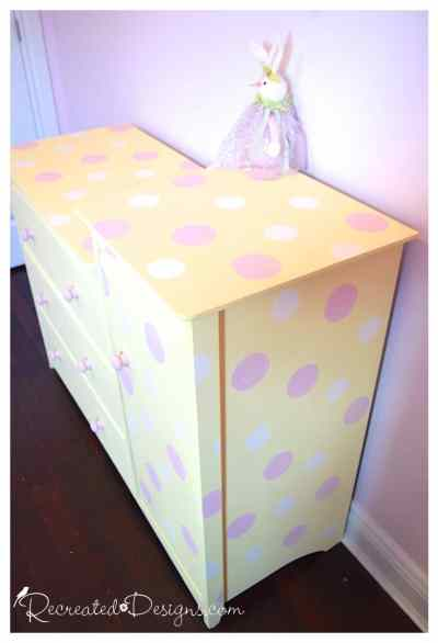 Pink and white painted polka dots on yellow change table