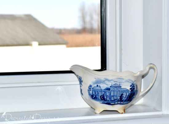 antique creamer in blue and white