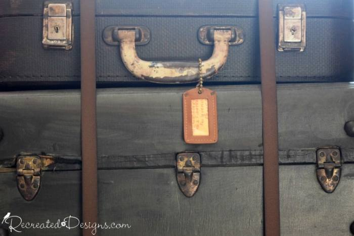 luggage tag hanging from vintage suitcases