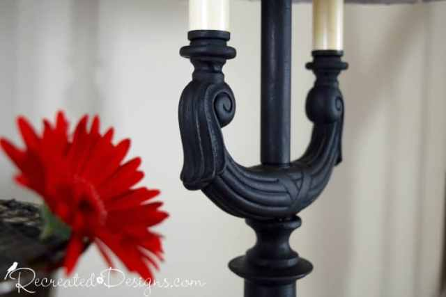 a close up of some Country Chic Paint in Licorice and a red flower