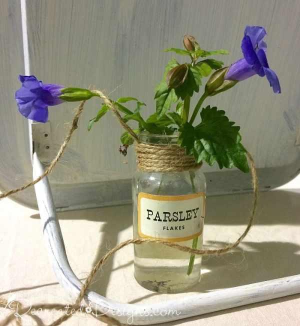 vintage spice bottle with purple flowers