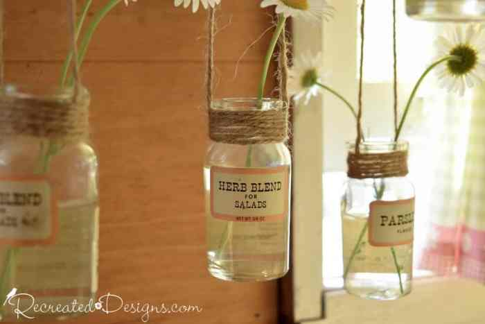 hanging spice bottles with wildflowers