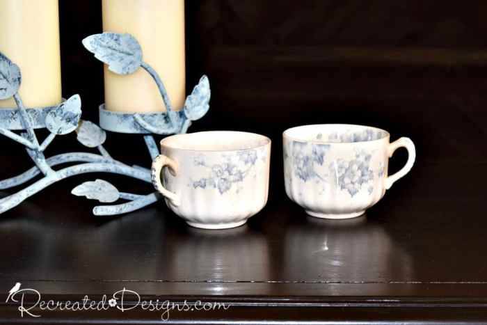 beautiful blue and white tea cups with candles