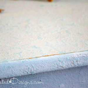 the texture of a coffee table painted with Milk Paint and Saltwash