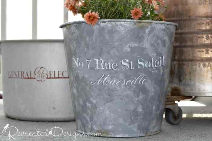 pained pail to look like galvanized metal with a French Script stencil on the side